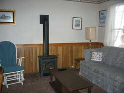 Living Room with Fireplace at Maple Court Cottages Port Dover Ontario Canada